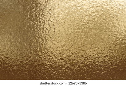 Close up on gold metallic background, real texture, best for texture festive background
