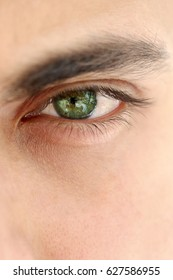 Close up on a green eye of a man