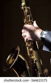 Close up on hand playing saxophone