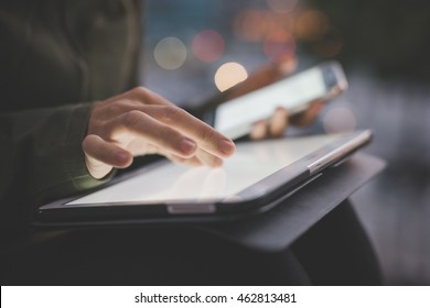 Close up on the hand of young handsome caucasian woman pointing and touching the screen of a tablet with her finger - technology, social network, communication concept