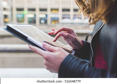 Close up on the hand of young woman using tablet - technology, social network, communication concept