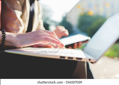 Close up on the hand of young woman using computer - technology, social network, communication concept