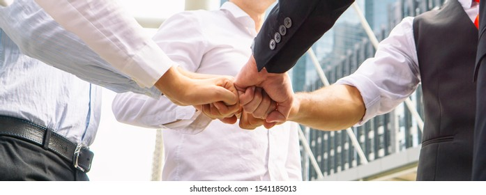 Close up on hands of business people join together on unity concept