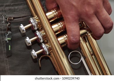 Close up on hands and trumpet