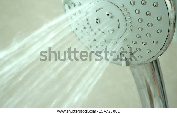close up on head shower while running water