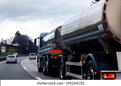 Close up on huge liquid transporting lorry on motorway