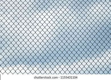 close up on iron chainlink fence against sky