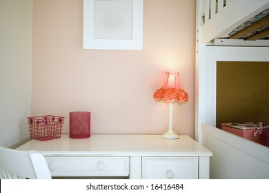 Close up on a kid's bedroom with desk and the bunk
