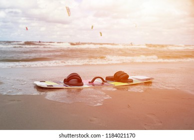 close up on kitesurfing board on the beach