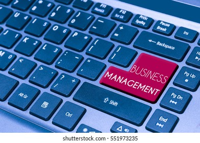 close up on a laptop keyboard with text BUSINESS MANAGEMENT