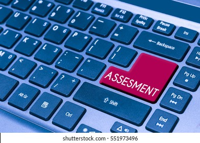 close up on a laptop keyboard with text ASSESMENT