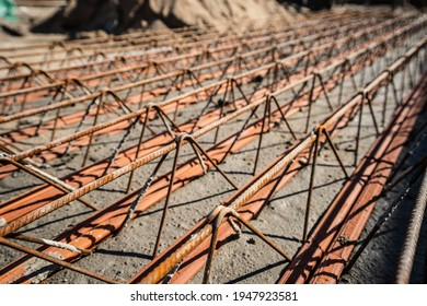 Close up on lattice girder and truss girders steel roof truss for concrete precast with ceramic elements ready for installation on the construction site or warehouse in sunny day