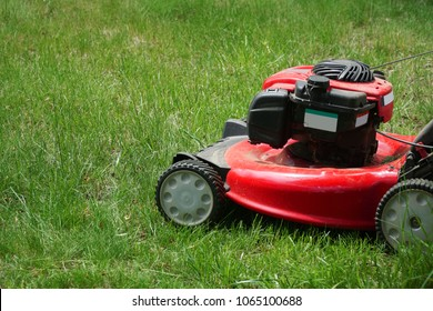 close up on lawn mower on green lawn