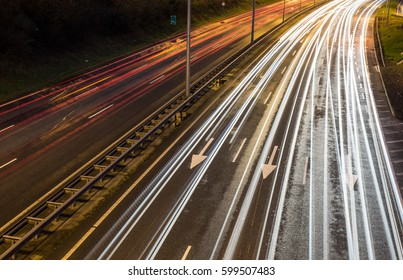 Close up on Light trails on motorway highway during evening rush hour