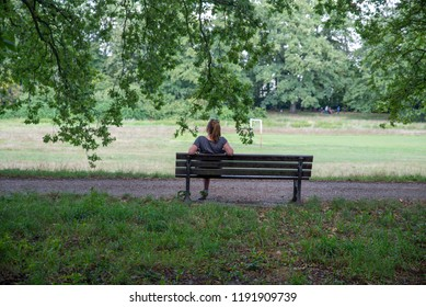 close up on lonely woman on the bench