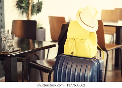 close up on luggage: suitcase and hand bag at the airport cafe