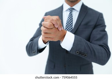 Close up on male clenched hands.