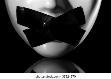 close up on masks mouth with masking tape on it ,on reflective surface , clipping path available