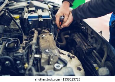 Close Up on Mechanics hands repairing opening car engine