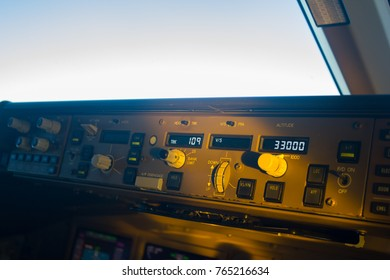 Close up on mode control panel of airplane, inside cockpit
