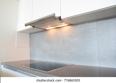 Close up on modern air exhauster kitchen fan or Range Hood. Stainless Steel Chimney Hood. Island Hoods. Cooker Hood