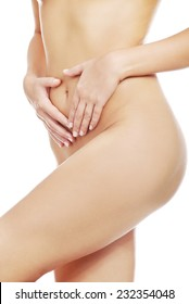 Close up on nude female slim body.