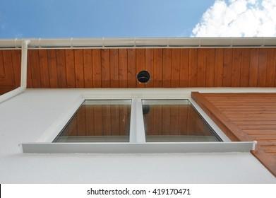 Close up on Outdoor Lighting & Exterior Light Fixtures.  Rain Gutter Soffit Board, Fascia Board Installation. Outdoor House Lighting Installation.