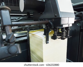 Close up on a paper feeding of offset printing machine