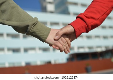 Close up on people holding hands together on sunny day outdoor background. Caring happiness togetherness. Walking natural holiday amazing destination view, joyful agreement, lifestyle positive time