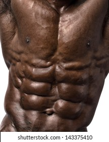 Close up on perfect abs. Strong bodybuilder with six pack.