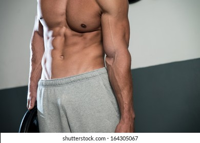 Close Up On Perfect Abs. Strong Bodybuilder Training His Six Pack. Man Doing Abs Exercise