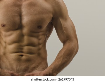 Close up on perfect abs. Strong bodybuilder with six pack, fit body