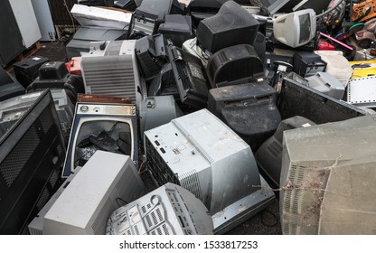 Close up on pile of broken televisions and computer monitors at an  electronic waste recycle centre