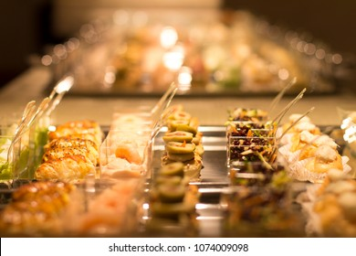 Close up on plastic containers with finger food.