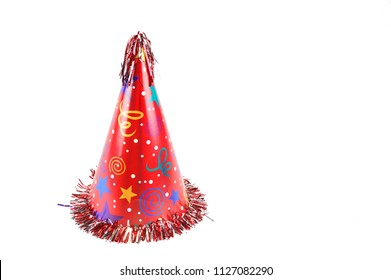 close up on red party hat isolated on white
