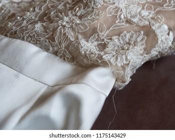 close up on ripped wedding dress
