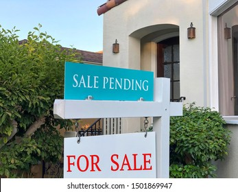 Close up on For Sale and Sale Pending sign in front of a California Home. Housing crisis, selling homes.
