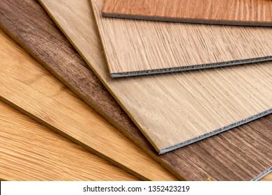 Close up on sample luxury vinyl floor sheet design for DIY flooring material decoration