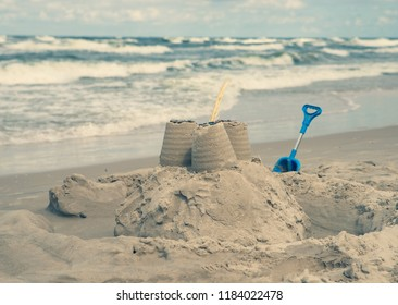 close up on sand castle on the beach, vintage effect