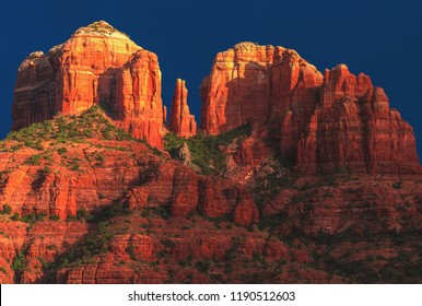 """A close up on the sandstone """"saddle points,"""" or gaps of Cathedral Rock, one of the most famous natural landmarks surrounding the desert town of Sedona, Arizona, in the Coconino National Forest, USA."""