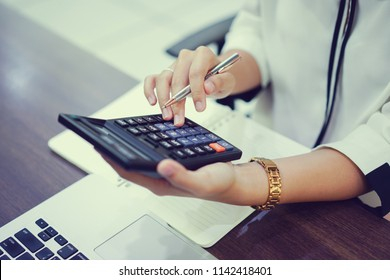 close up on senior accountant woman hand press on calculator for computing,working concept.