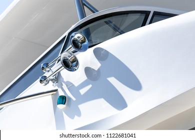 Close up on a shiny chrome air horn on helm of a luxury fiberglass yacht