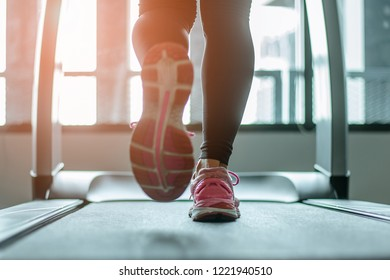Close up on shoe,Women running in a gym on a treadmill exercising concept fitness and healthy lifestyle