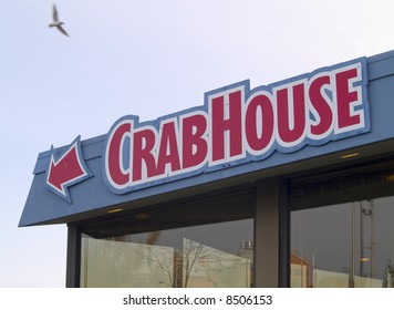 """A close up on a sign that says """"Crab House."""" This is a generic sign, not the name of the restaurant."""