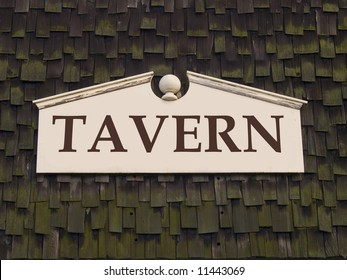 A close up on a sign with the word TAVERN on it.