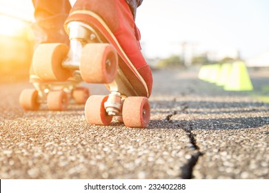 close up on skates. concept about sport and leisure. skater wants to perform a slalom between the cones