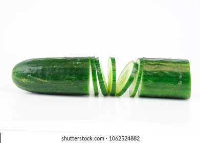 close up on sliced cucumber on white background
