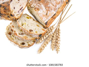 close on slices of bread grape and ears of corn on white background