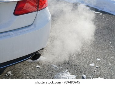 Close up on smoke from car pipe exhaust in winter season