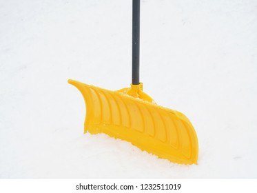 close up on snow shovel in the snow